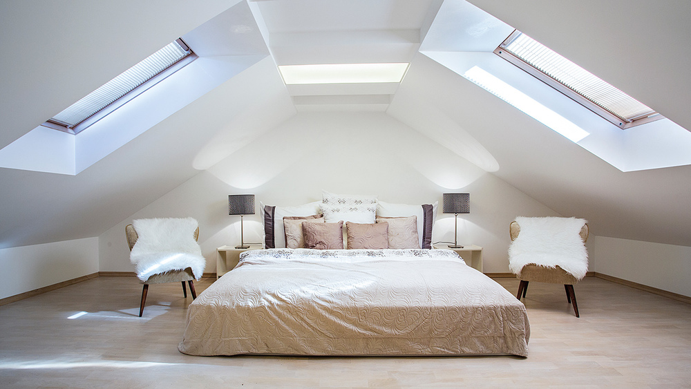 Large loft conversion bedroom with skylights