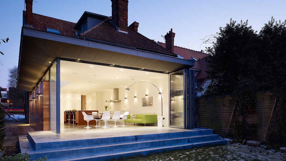 External view of large, modern home with bi-folding patio doors