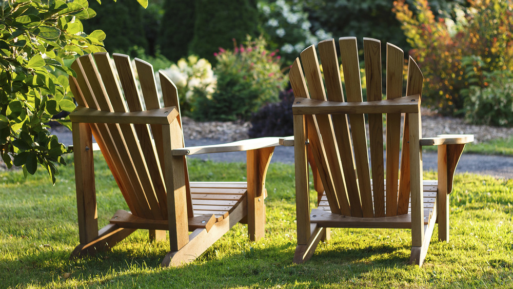 Wooden sun loungers on lawn