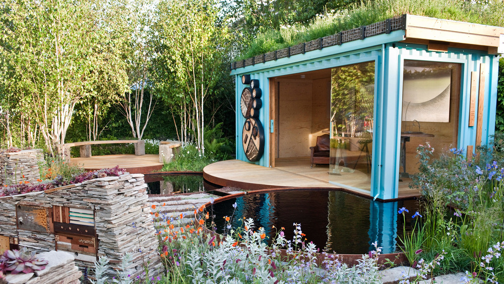 Modern garden with water features and shipping container summerhouse