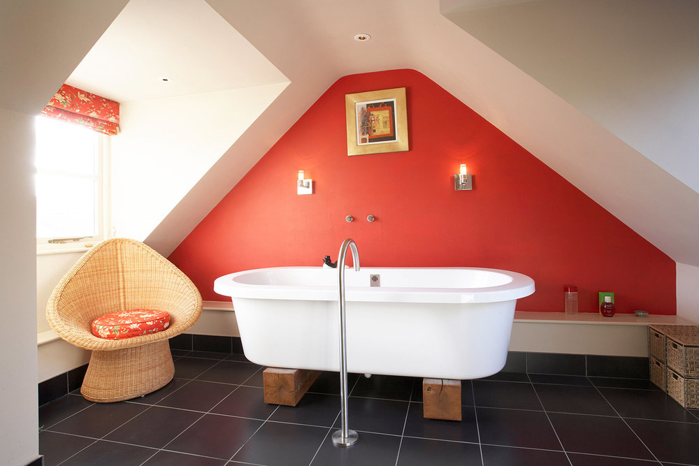 White bathroom with red feature wall in loft of property