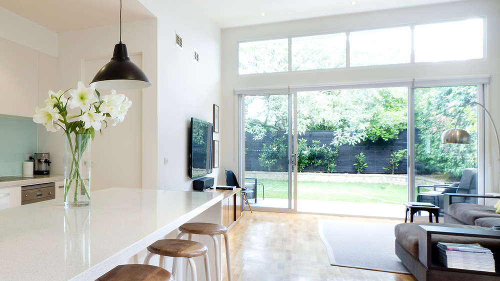 Open-plan kitchen with large sliding patio doors