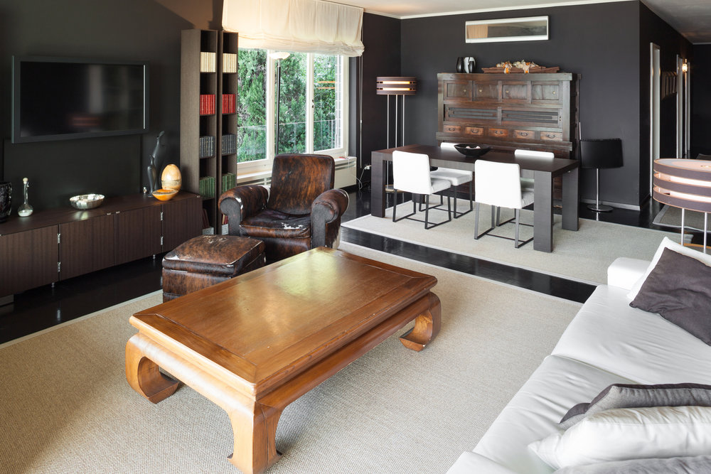 black walled living room with cream rugs