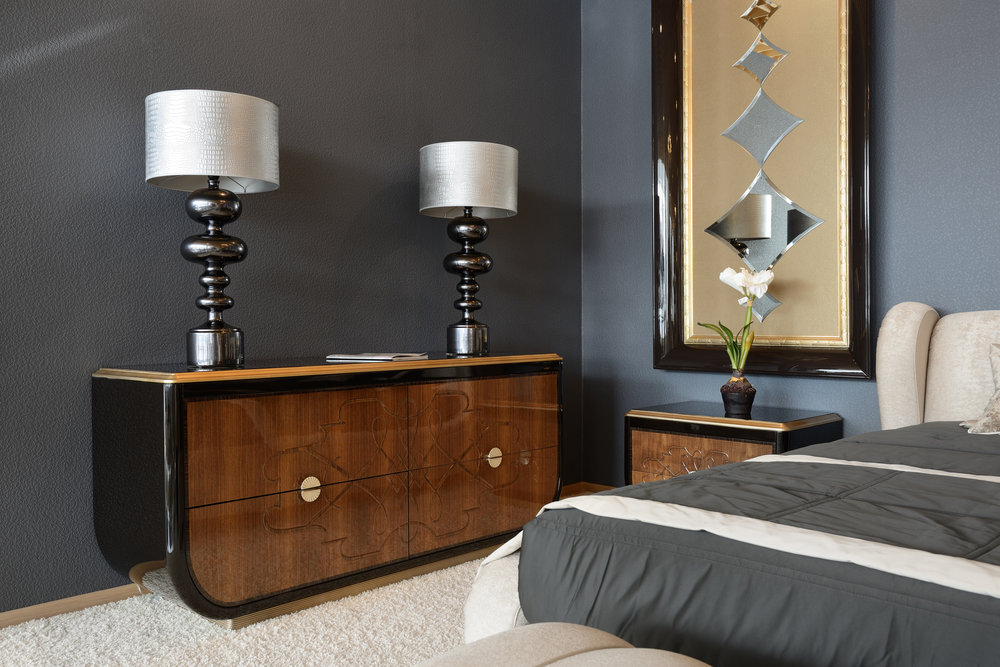 a guest bedroom with dark colour scheme