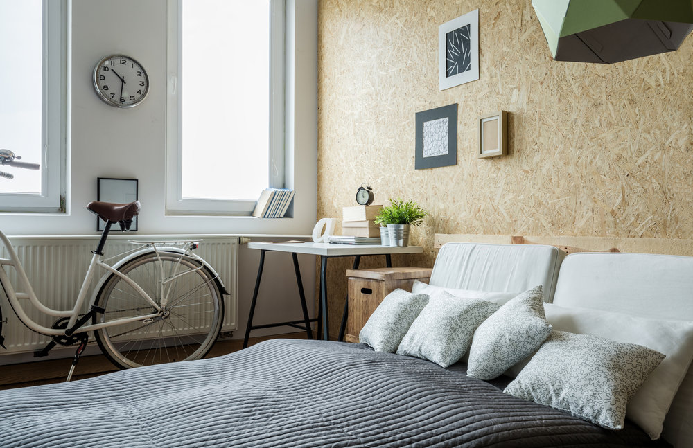 a very contemporary bedroom with bicycle in it