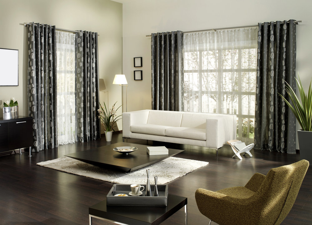 a white walled living room with white sofa