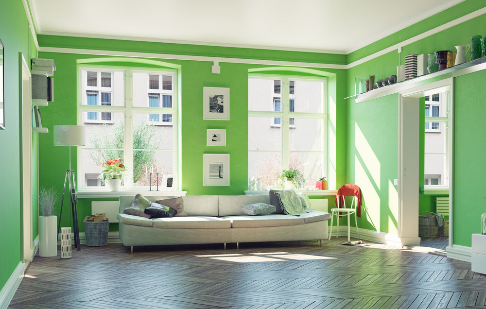 a green living room accented with white