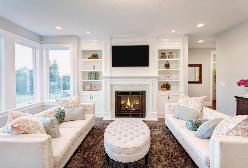 A Luxurious Living Room Decorated In Mostly White Shades