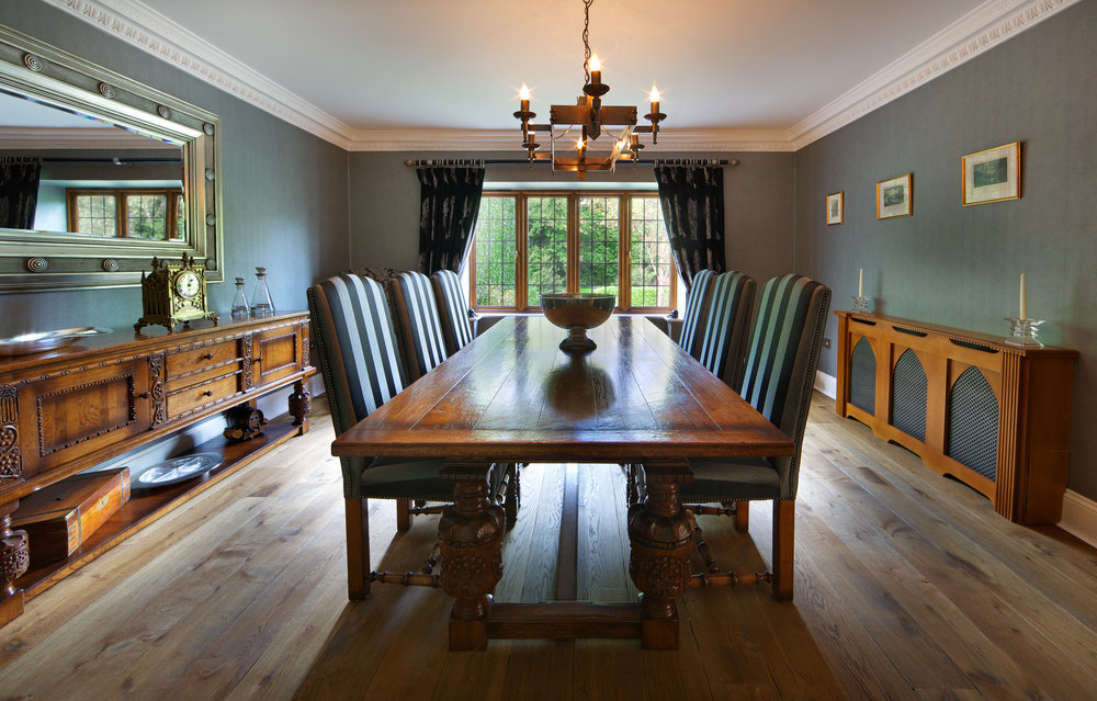 Large, traditional dining room table in long room