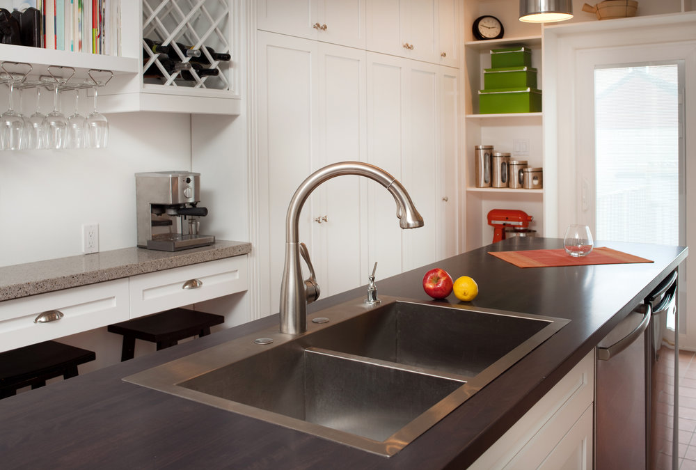close up of faucet in a modern kitchen.