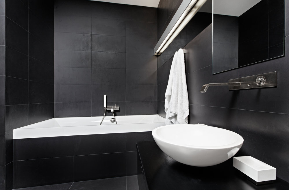 A chic modern en-suite bathroom with a black and white colour-scheme.
