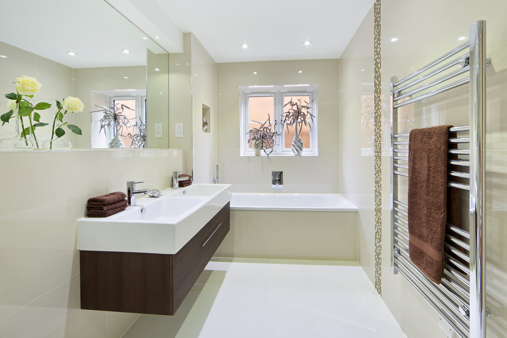 Trendy bathroom with long, floating, vanity unit.