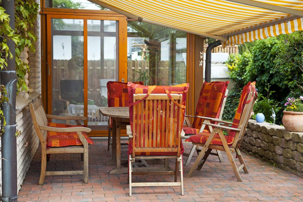 Garden furniture beneath awning