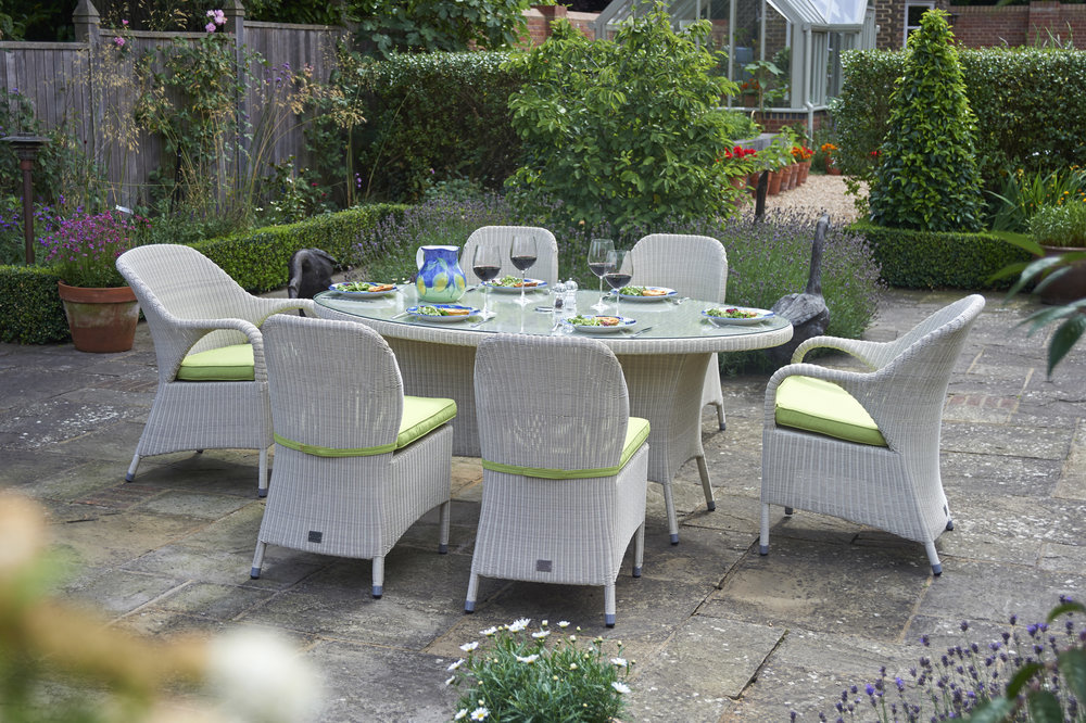 Photo Credit: Bridgeman. Rattan Garden Dining Set 180cm Sussex Oval Dining Table With 2 Dining Armchairs And 4 Dining Chairs. Price £2099.00.  www.bridgman.co.uk