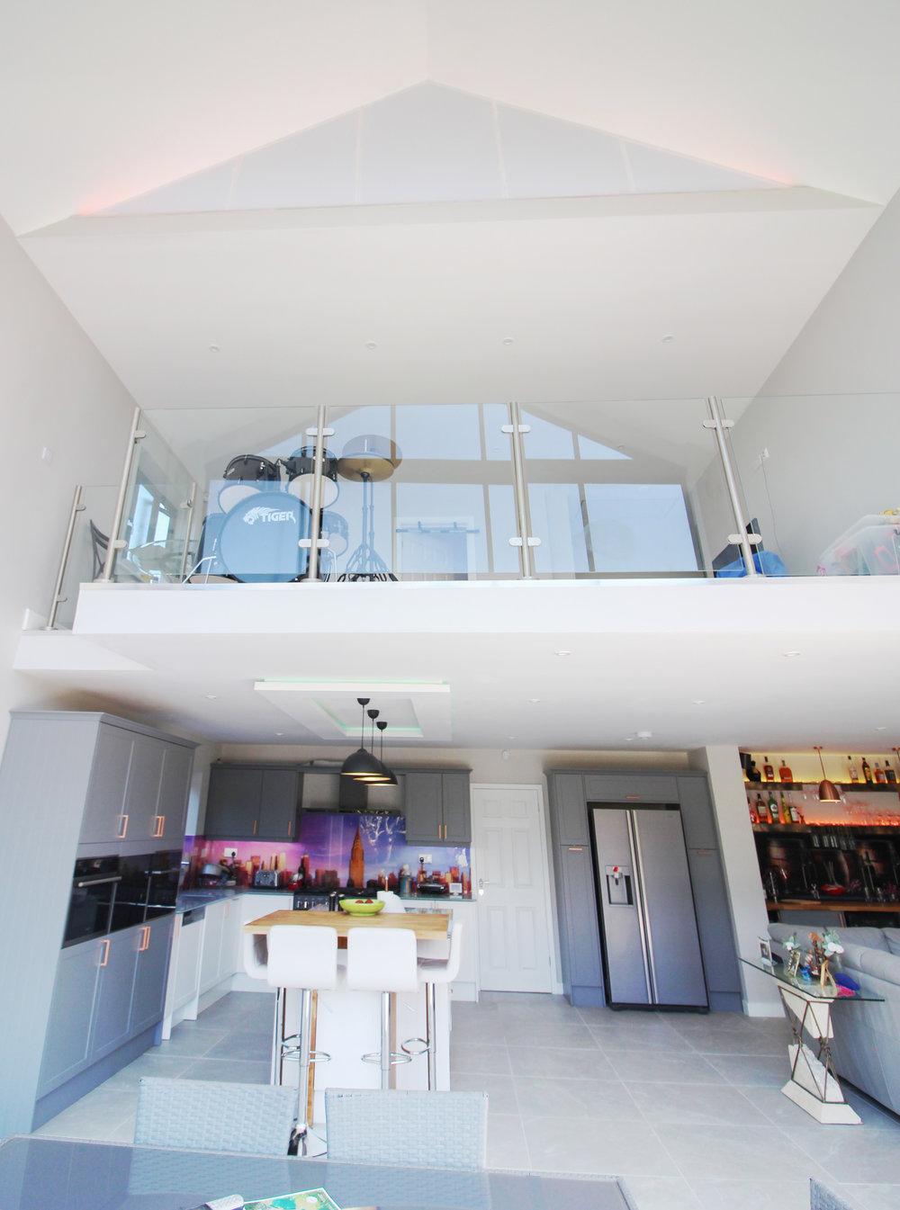 The view from the backdoor... - The upper level mezzanine floats effortlessly over the kitchen area. This creates a bright and friendly atmosphere when entering the new space.
