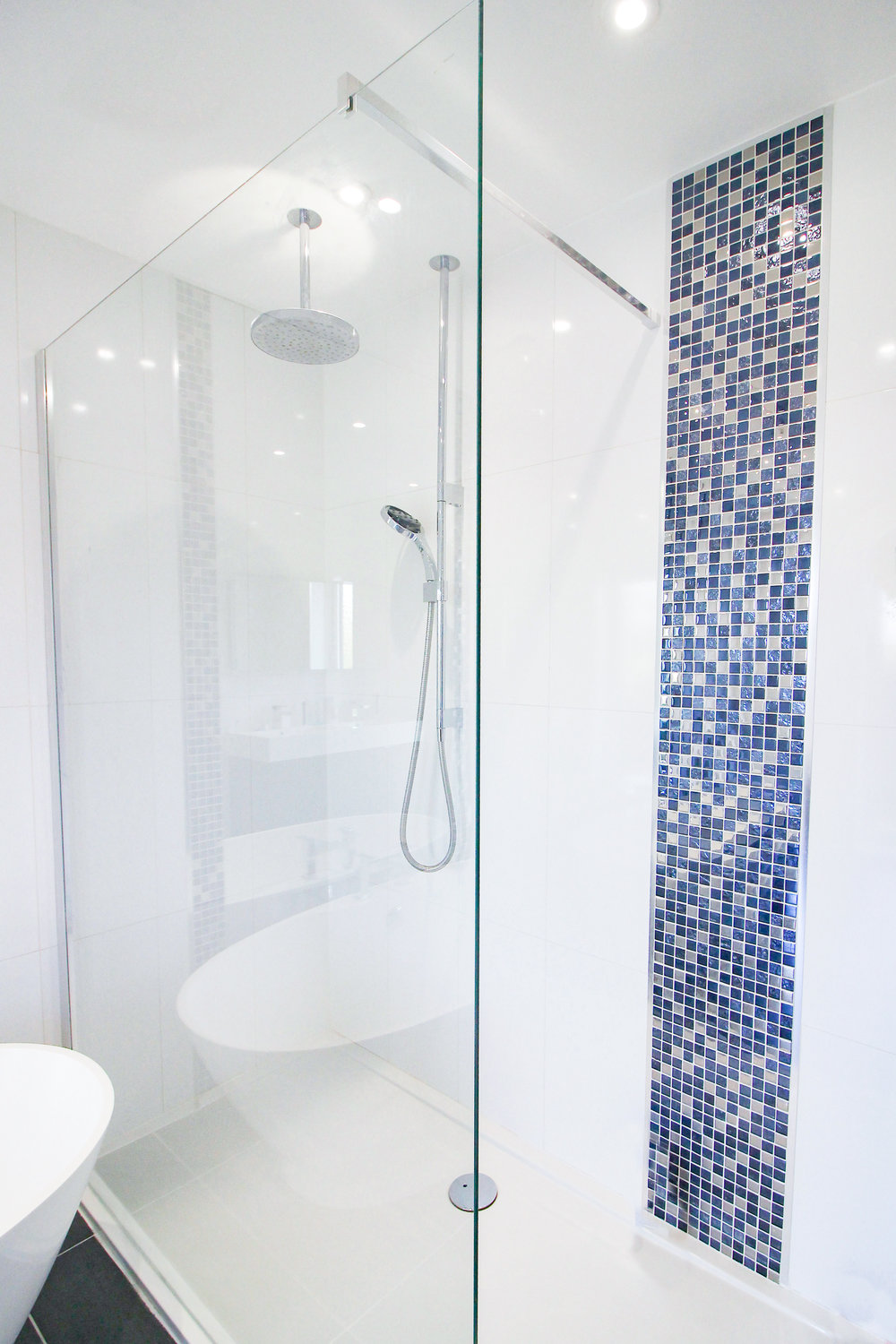 Power Shower... - Of course, you don't always have time to leisurely soak in a bathtub no matter how magnificent it may be. That's why the family bathroom also features this powerful walk-in shower which offers a deeper cleanse in half the time