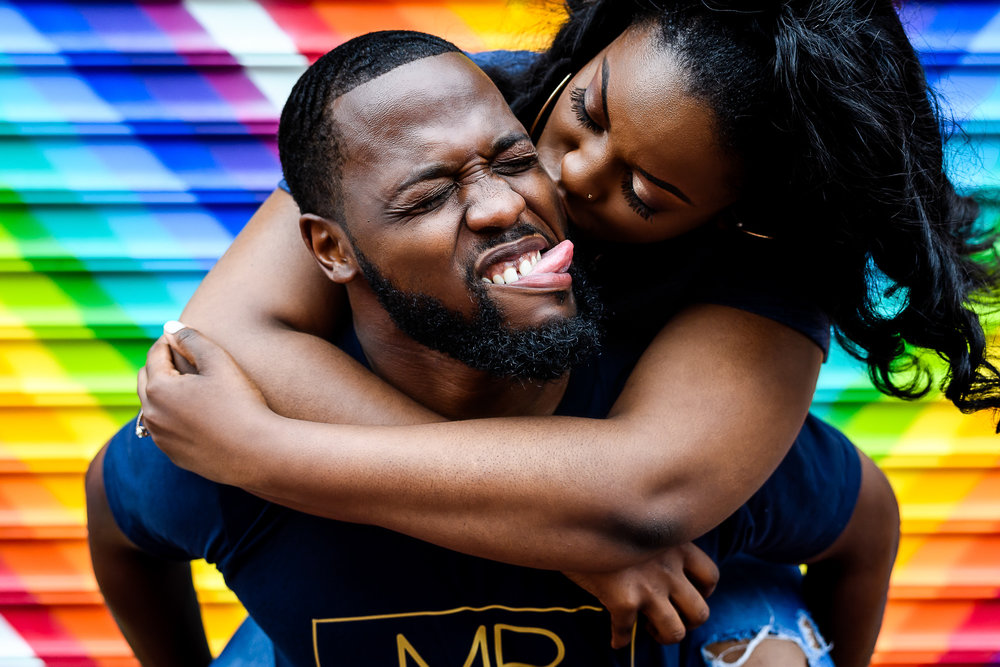 001-christopher-jason-studios-washington-dc-graffiti-alley-engagement-session-african-american-couple-kisses-while-riding-on-his-back.jpg