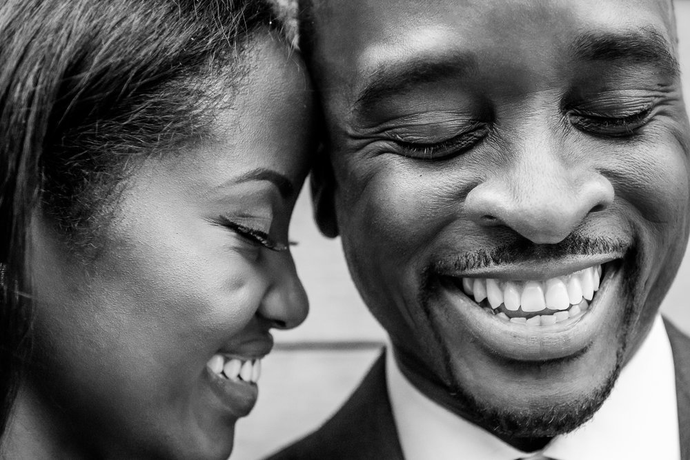 004-christopher-jason-studios-washington-dc-wharf-engagement-session-nigerian-couple-laughs-together.jpg