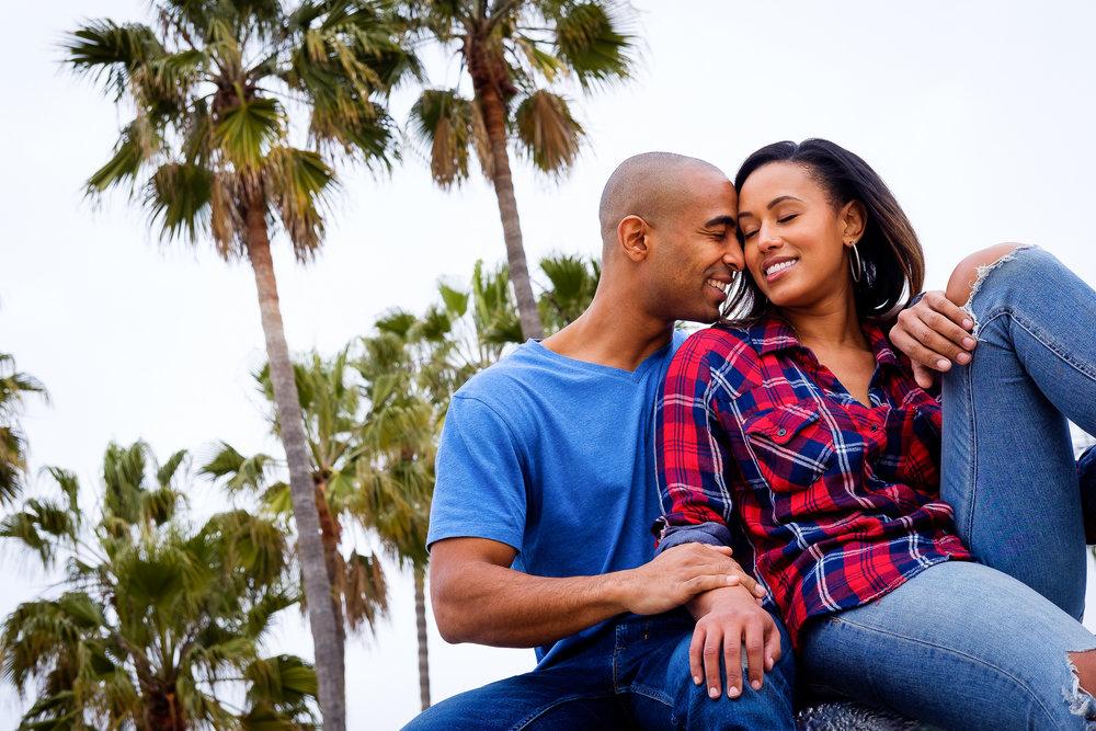 006-christopher-jason-studios-venice-beach-california-engagement-session-african-american-couple-embraces-under-palm-trees.jpg