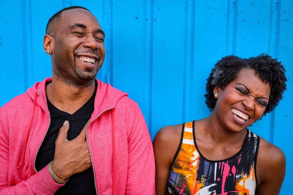 012-christopher-jason-studios-washington-dc-national-gallery-of -art-engagement-session-african-american-couple-laughs-together-on-blue-wall.jpg