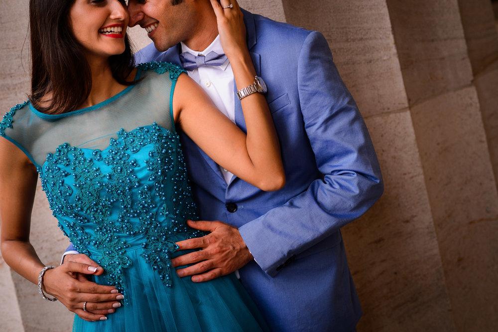 013-christopher-jason-studios-washington-dc-national-portrait-gallery-engagement-session-indian-southeast-asian-couple-embraces-on-pillars.jpg