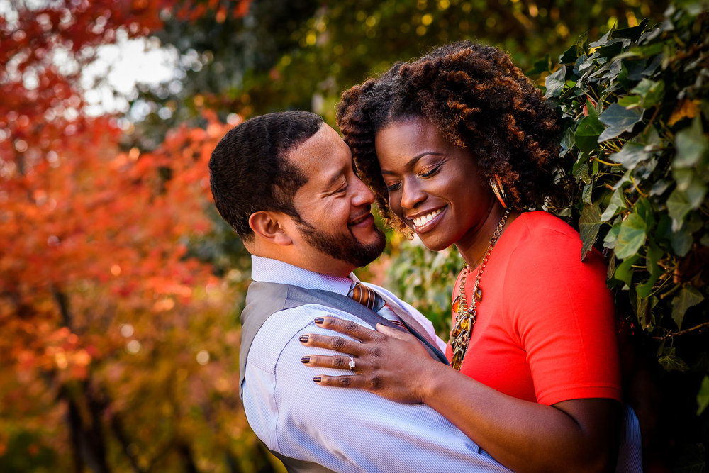 020-christopher-jason-studios-washington-dc-georgetown-autumn-engagement-session-african-american-couple-embraces-near-fall-leaves.jpg