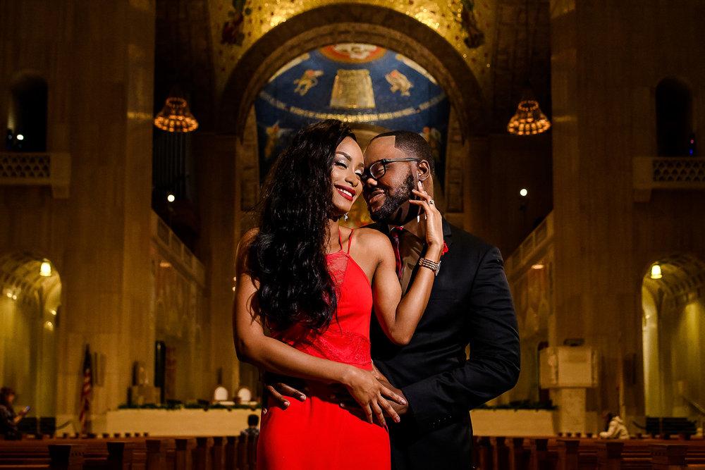 024-christopher-jason-studios-washington-dc-historic-trinity-chapel-engagement-session-nigerian-couple-embraces-near-altar-and-pews.jpg
