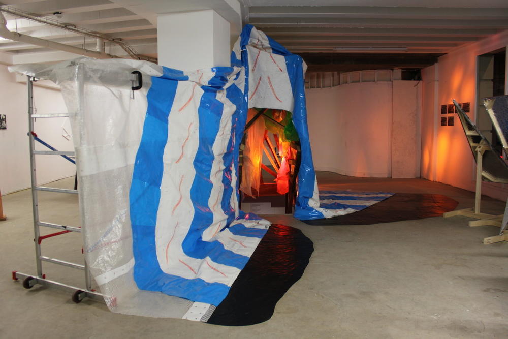 Circus Curtains , scaffold tower, scaffold sheeting, rubble sacks, rubber flooring, various plastics, light gels, Par 64 lights x 3, clamps, emulsion paint, marker pen, 330cm x 510cm x 300cm, 2014