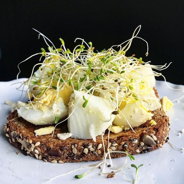 Falling in love with sprouts more and more each day. Hard boiled farm egg with sunflower butter, @bloomsburyfarm sprouts and @herbanmarket1 olive oil on Ezekiel bread! #bloomsburyfarm #sprouts #farmtotable #shoplocal #herbanmarket #bonappetit #kinfolktable #bedeeplyrooted #yum #foodie #foodphotography
