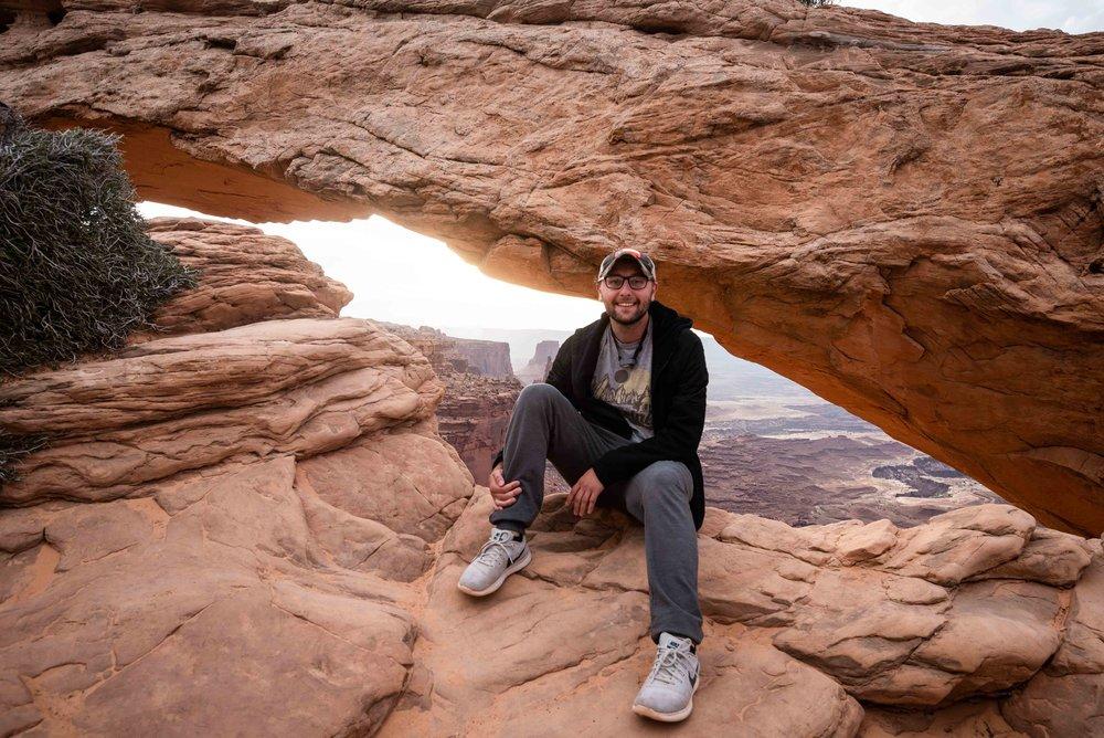 Trevor at Mesa Arch-1.jpg