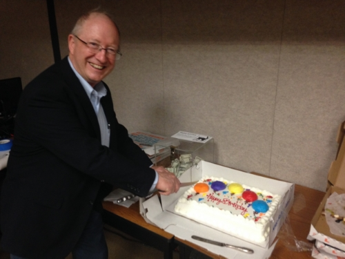 AGS celebrated its 50th Anniversary. President Jack Sharp cuts the cake at the May 2015 meeting.