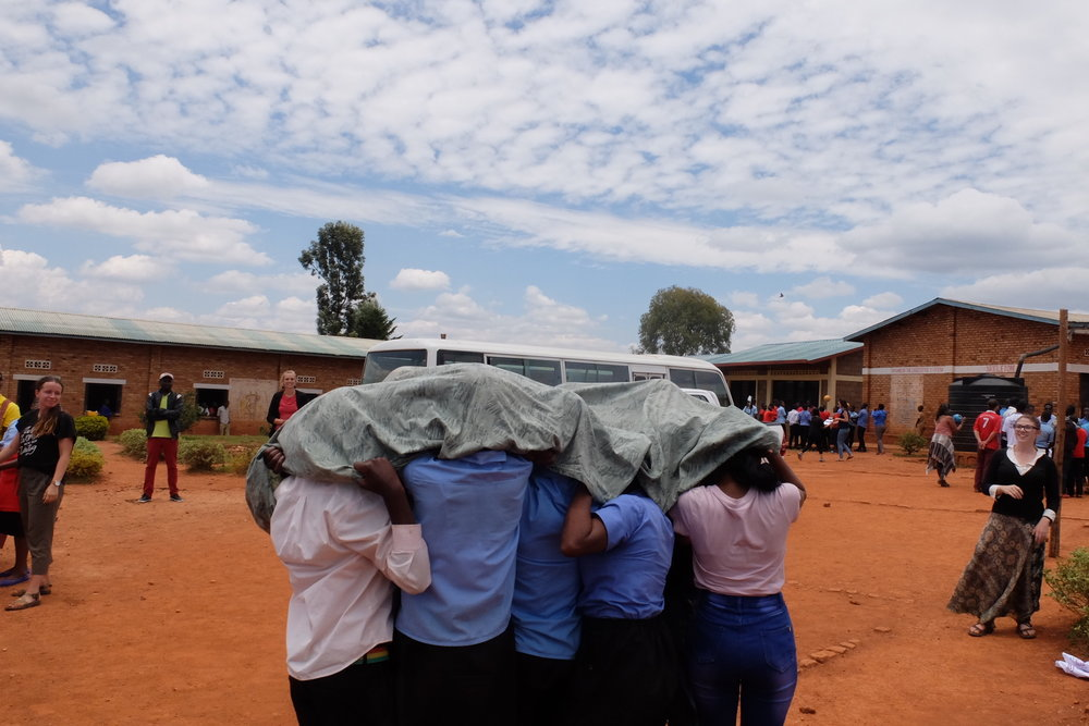 Students play the game Net Ball during a STOMP program. Net ball teaches the importance of using a net and seeking treatment early if experiencing symptoms of malaria.