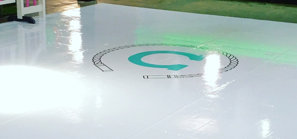 White Wrapped Dancefloor with Custom Vinyl Monogram