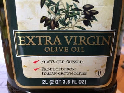 This is the front label of the bottle. Notice it states Extra Virgin Olive Oil, First Cold Pressed, is a dark bottle to stop the light from going through to degrade the oil, and it tells me what country the olives were grown in, or country of origin.