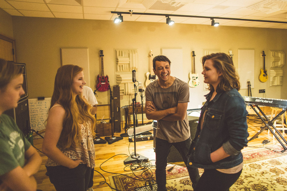 Students Angela (12th Grade) Sarah (9th Grade), and Grace (10th Grade) working with Jerome from the Grammy-winning platinum record-selling band     Switchfoot     at the     Songbirds's Studio    .