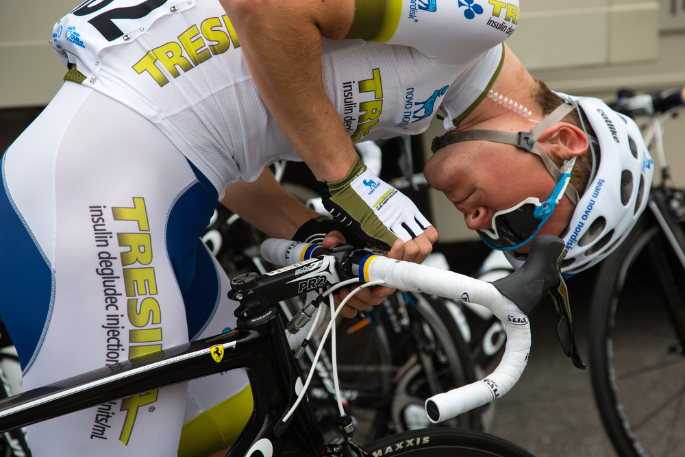 A Team Novo Nordisk rider makes final adjustments before the race.