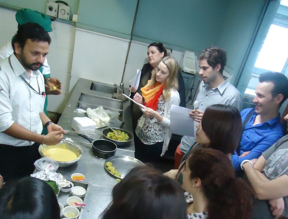 Making traditional dishes with the client's cooking staff. Photo courtesy of client.