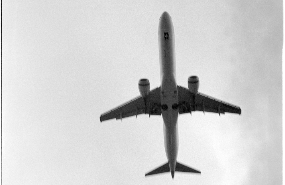 aeroplane There's a place just 4km north of Tullamarine airport where you can park and watch various aircraft come in on their landing approaches. Well alright, not everyone's cup of tea (although there is a coffee van there and I'm sure they'd do tea if you asked nicely) but I quite enjoyed the exercise of trying to get some pictures over the course of an hour or so. One of my cameras had a meltdown while I was doing it and I'm not sure if this led to the dark patch on the right hand side. Turns out that part of the circuit board fried and disabled the camera's ability to take shots on a manual exposure setting. I now have a replacement camera (that one was, in fairness, over thirty years old) so I guess I could go back and do it again - if the flight of fancy takes me. Now that I look properly, these things are rather beautiful, aren't they.
