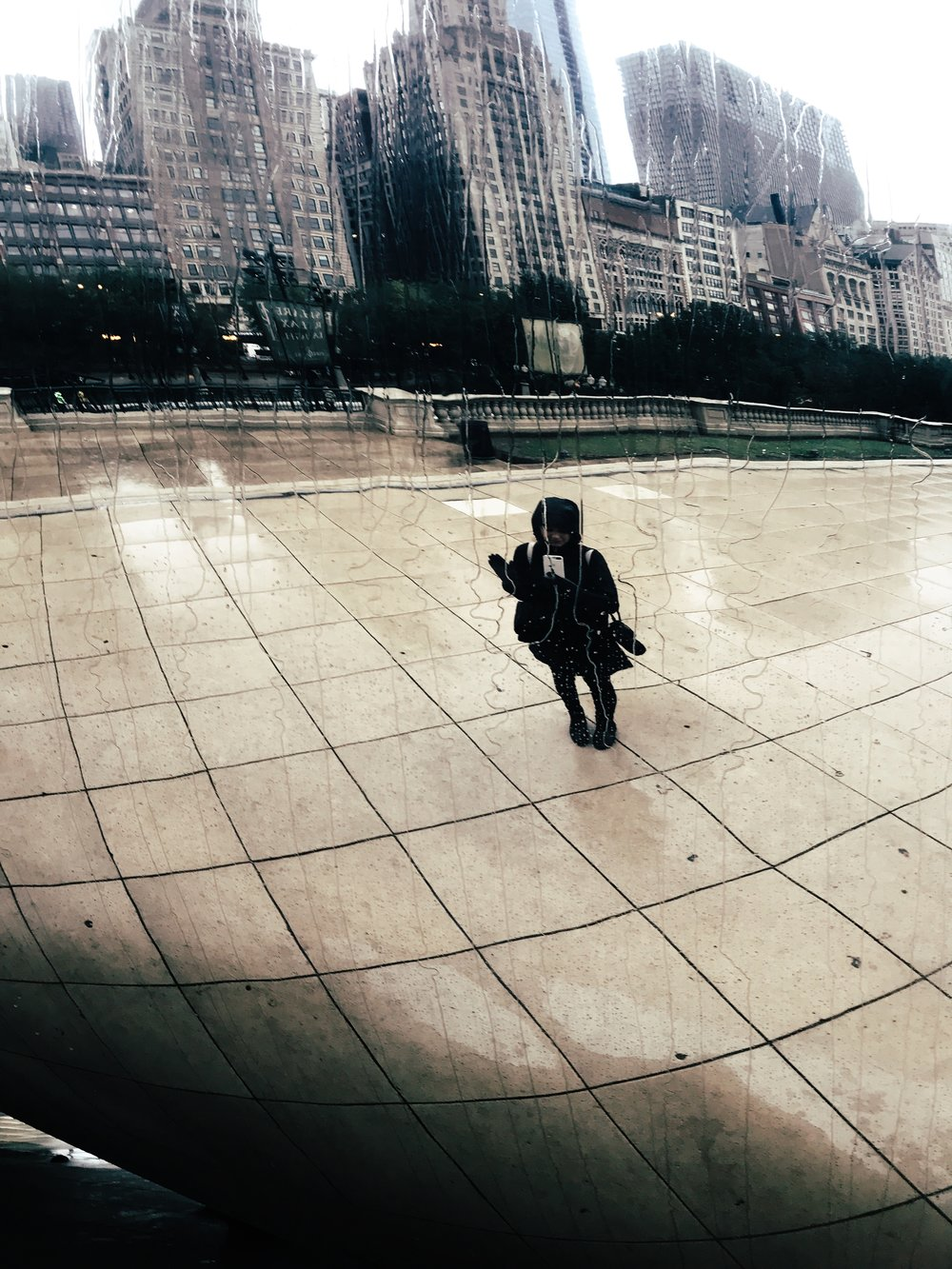 Somewhere buried under a rain jacket at Cloud Gate
