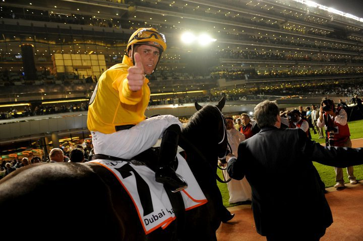 Garret Gomez gives a thumbs up after riding the horse to victory in the Dubai Golden Shaheen.