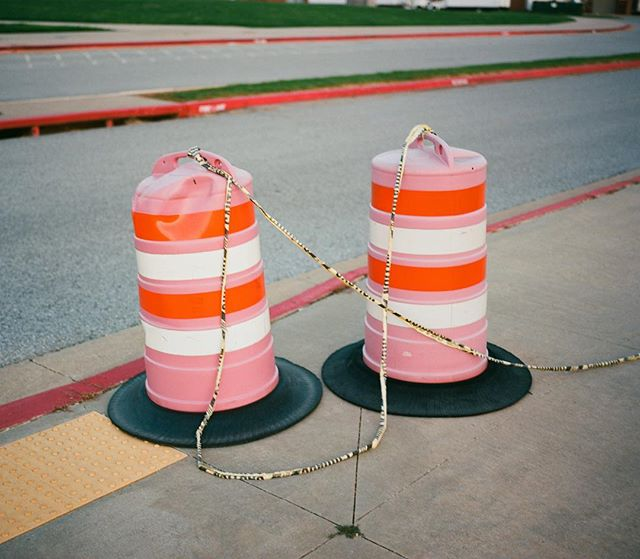 A pair of sun-faded traffic cones. #ektar100 #mamiya7 #mediumformat