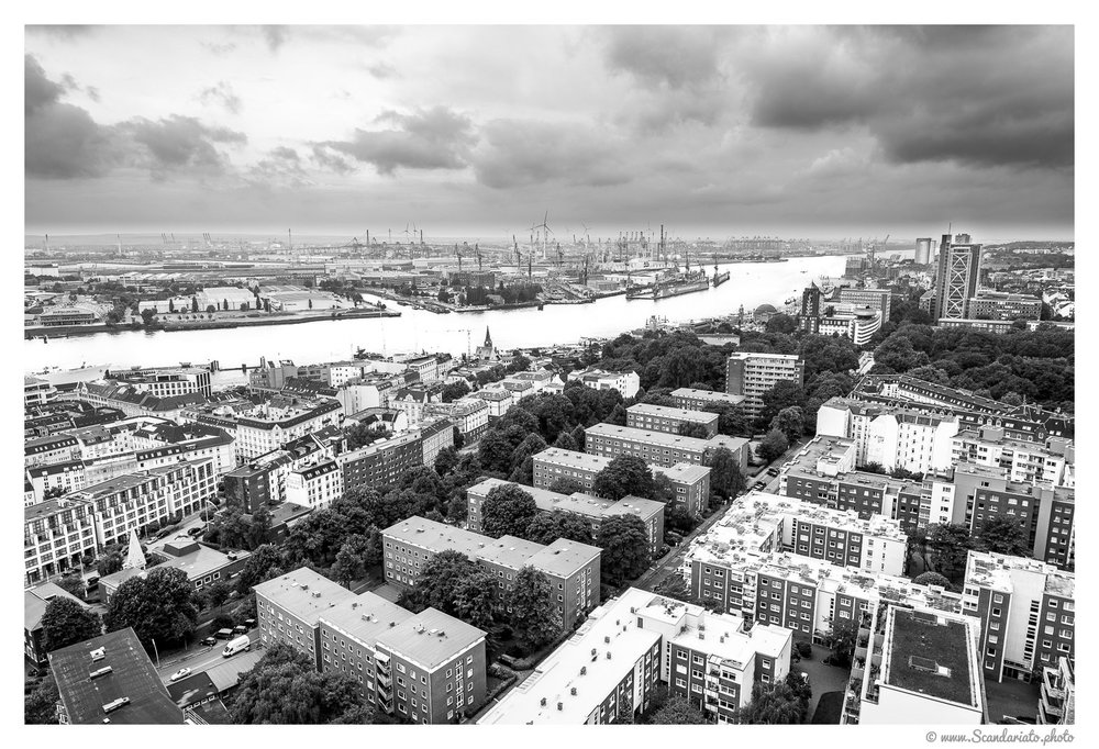 View of the Elbe river and the Burchardkai harbour. 24mm on full-frame. 1/200 sec, f/5.6, ISO 100