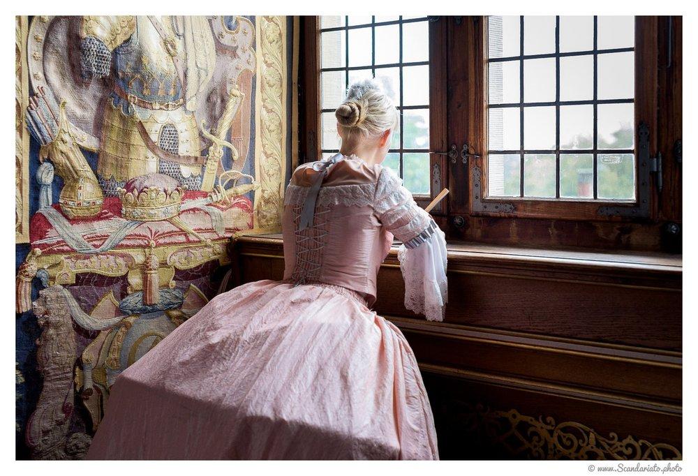 Waiting for her lover. 50mm on full frame,1/100 sec, f/2, ISO 800