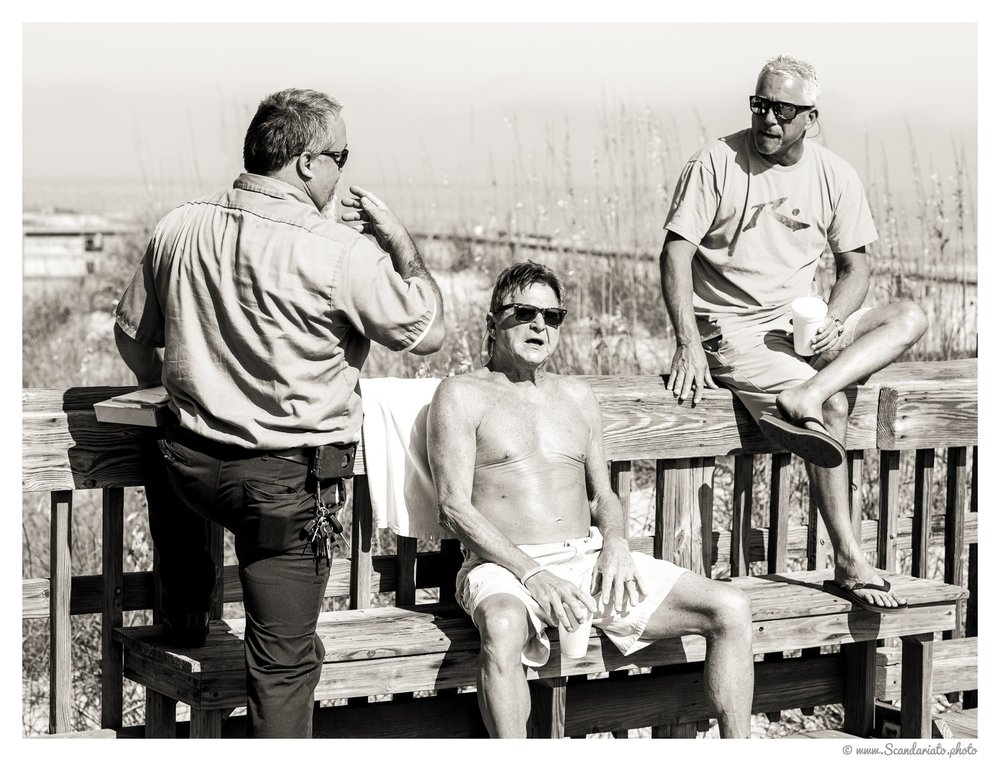 Chatting in the sun at Tybee Island. 85mm on full-frame. 1/1250 sec, f/5.6, ISO 200