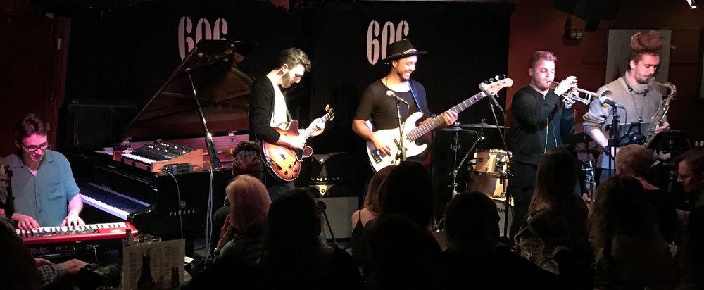 J Stevenson-Oliver / keys, Mikayl Dawood / guitar, M Dos Santos / bass, C Silva / drums, J Mathod / trumpet, G Virgilio Pribetti / saxes.