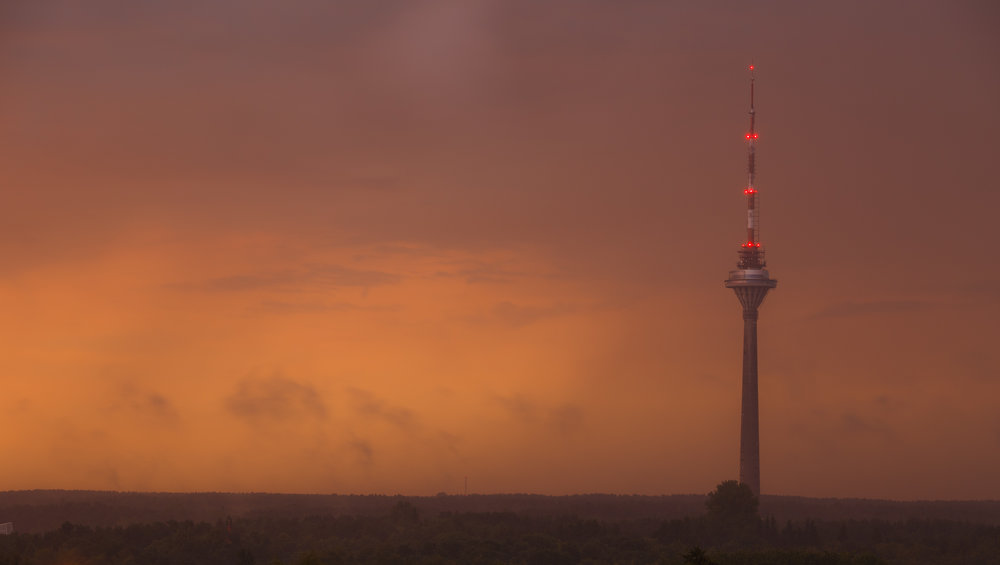 August 2017: The sky right after a scary thunderstorm was grey and black. When the sun started setting, it broke through the clouds on the horizon, letting a bright orange light through as if Tallinn was on fire.