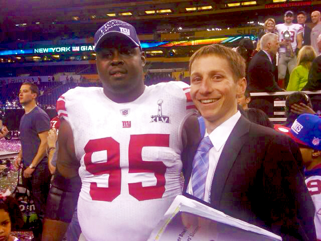 Dan August with New York Giants' defensive tackle Rock Bernard at the XLVI Super Bowl