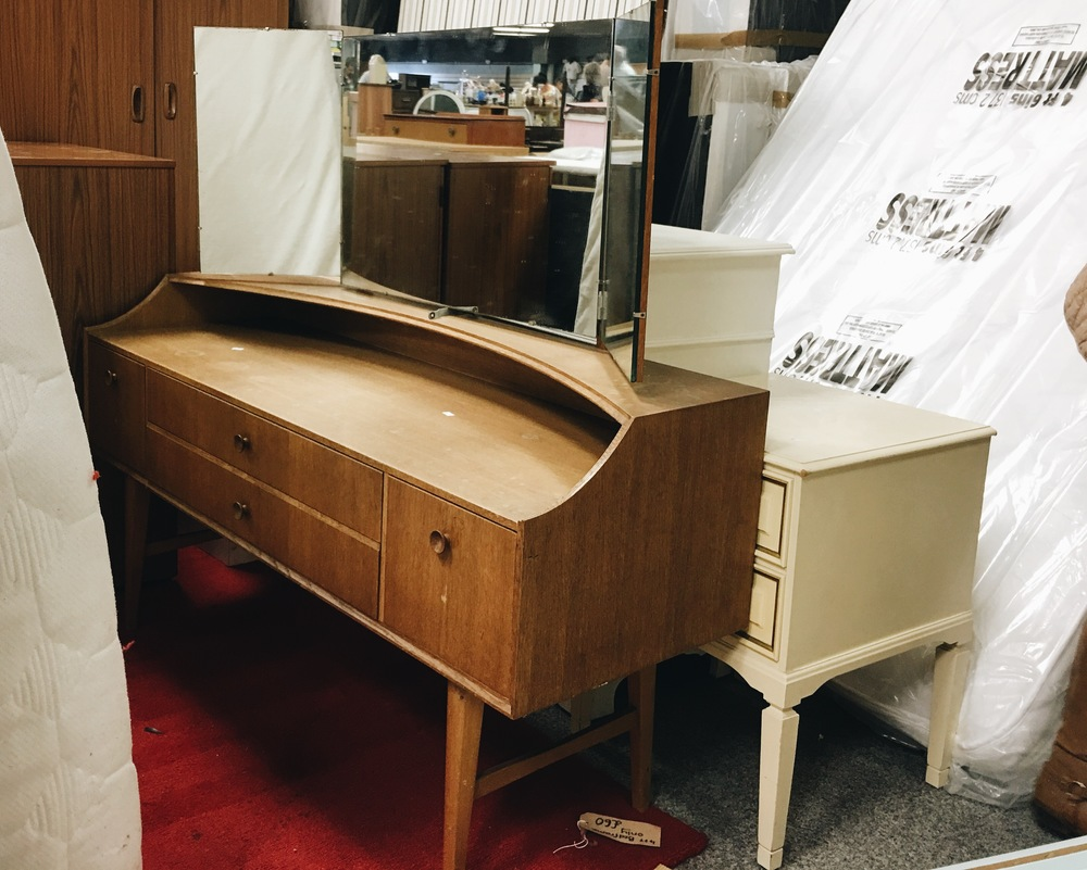This lovely mid-century modern style dressing table was hiding behind a mattress.