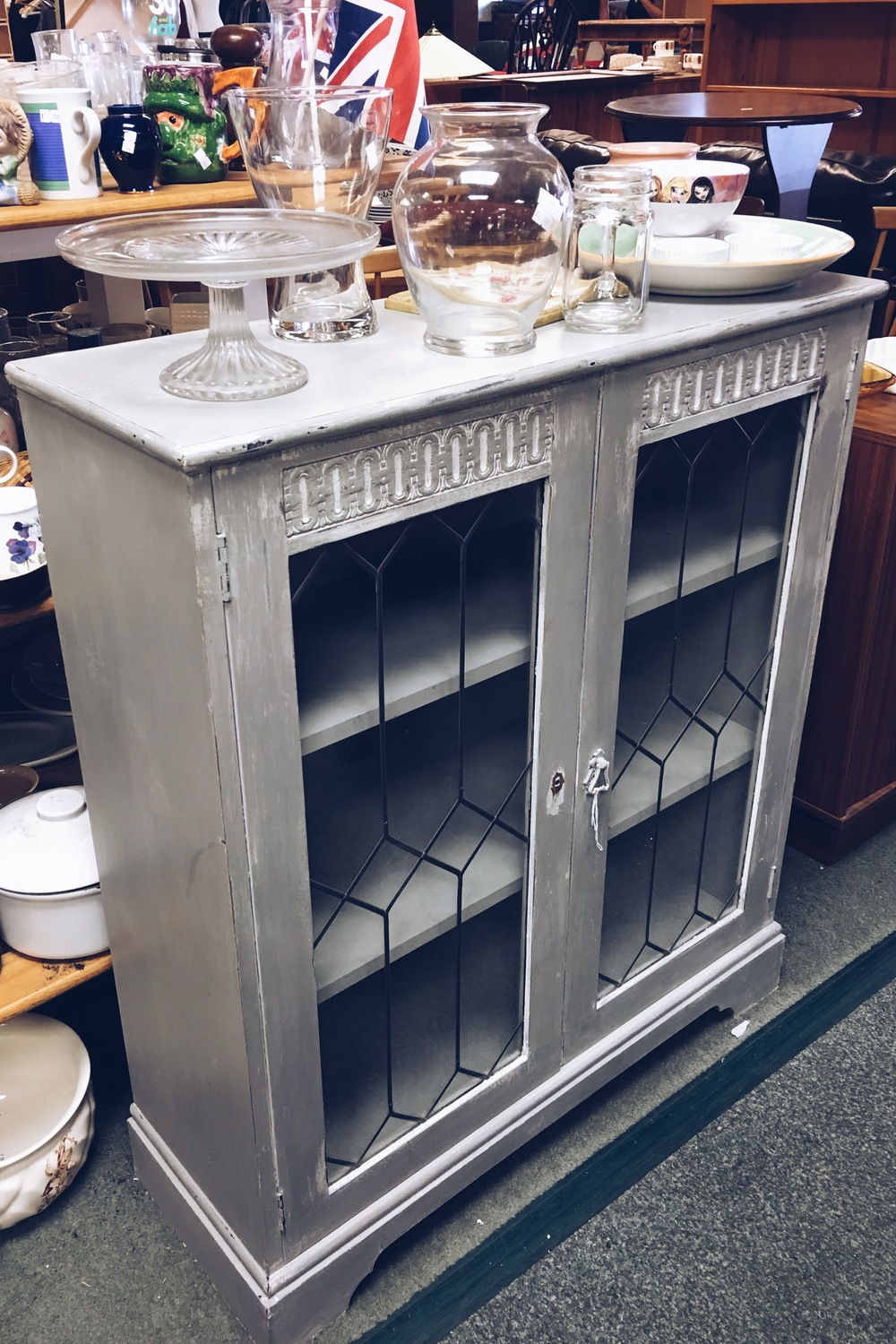 This cabinet had already been 'shabby-chiced,' but when you look for items think what they could look like with a new coat of paint or varnish.
