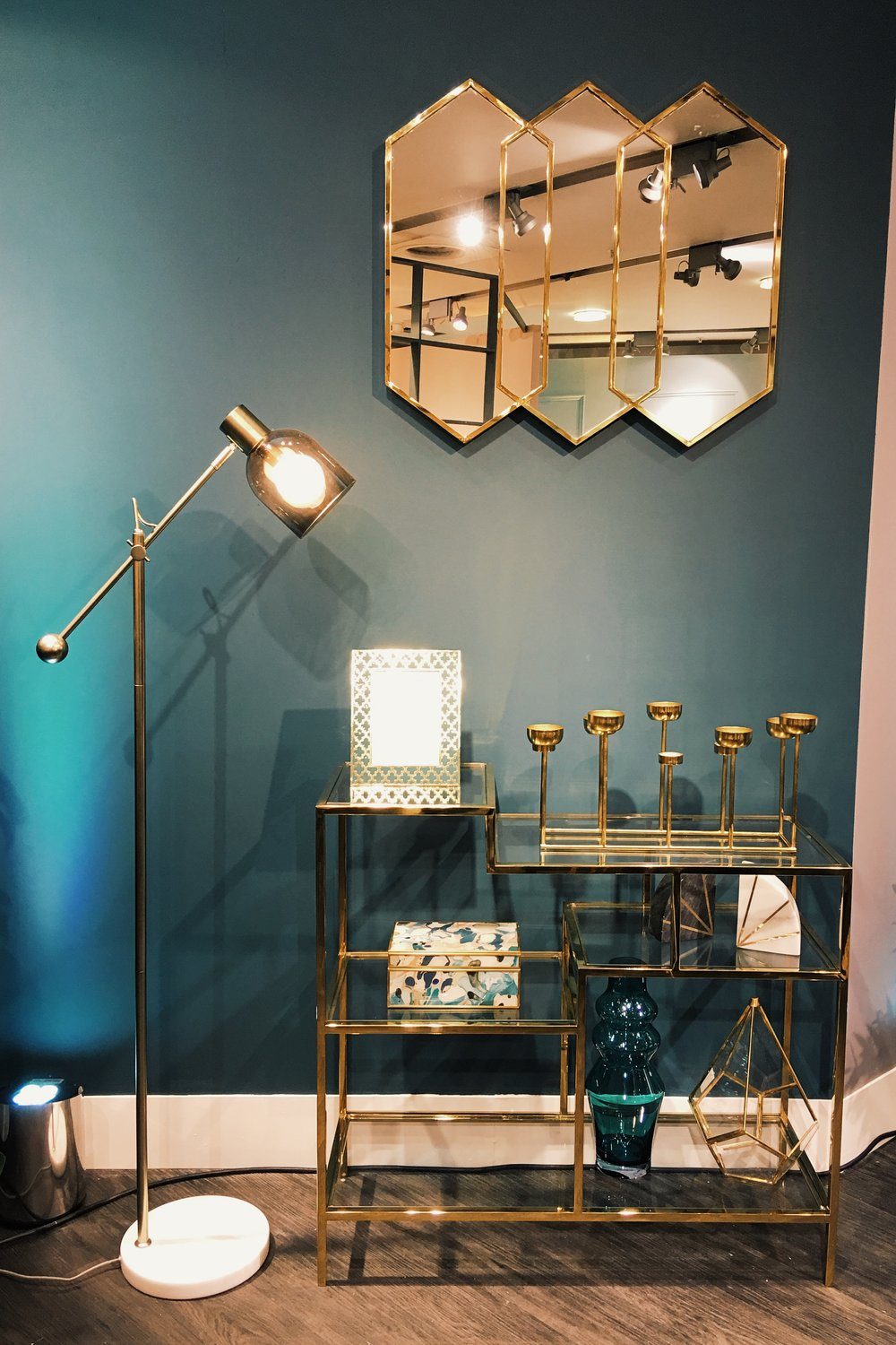Conran Caleb Task Floor Lamp, £149. Barclay Shelving, £399. Triple Geo Mirror, £149. Multi-tea Light Holder, £49.50. Conran Marble Book Ends, £29.50 for the set. Aria Trinket box, £29.50. Gold Triangular Hurricane, £29.50. Conran Tall Vase, £29.50. Photo frame TBC. All M&S.